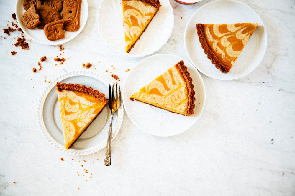 pumpkin pie with a speculoos cookie crust and a crème fraîche swirl