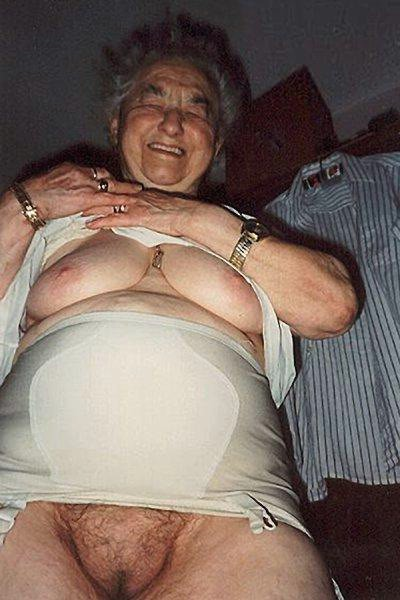 happy old grandma lifting her clothes