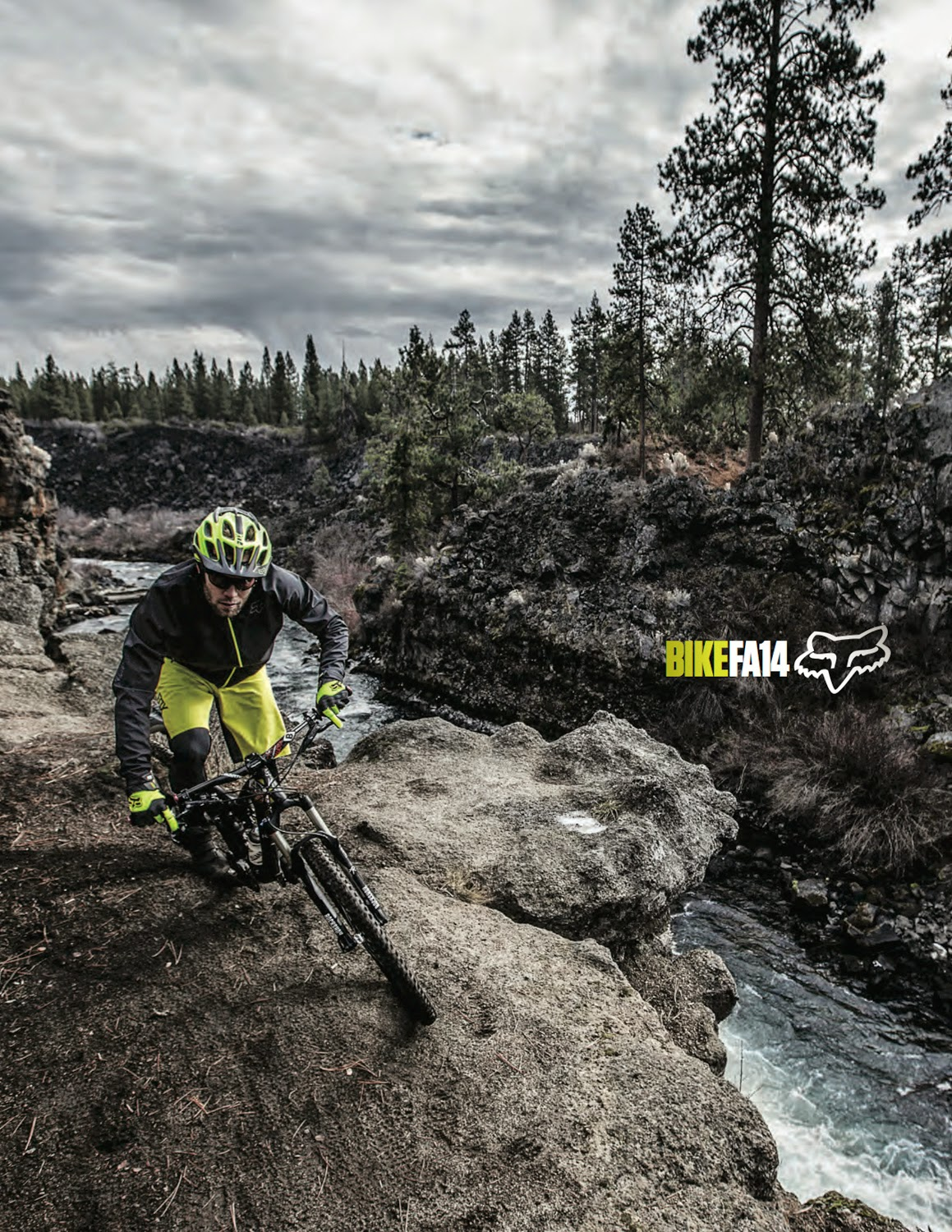 Kirt Voreis mountain bikes next to the Deschutes River in the new Fox Head Catalog.
