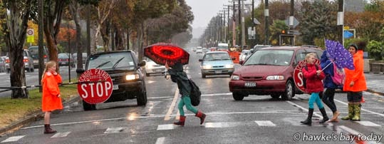 Umbrella problems - School patrol outside Onekawa School, Kennedy Rd, Napier - rain, wet weather photograph