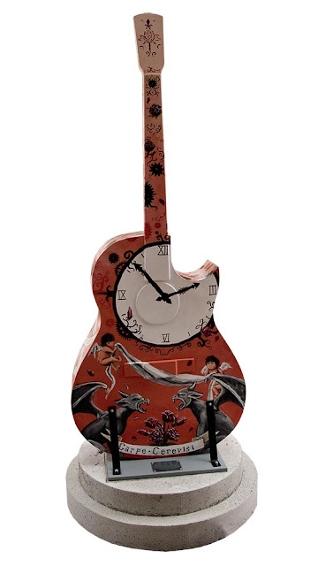 Orillia downtown, painted guitar displays, deep red guitar with painted clock and angels design