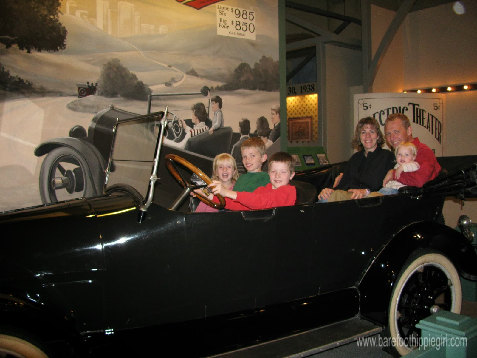 family in antique car