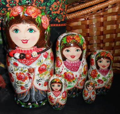 Nesting dolls (matryoshka) with painting in russian style handmade with Flowers by palette knife.