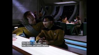 "Worf bends in towards LaForge at the bar of Ten Forward, saying ""You must let her see the fire in your eyes."""