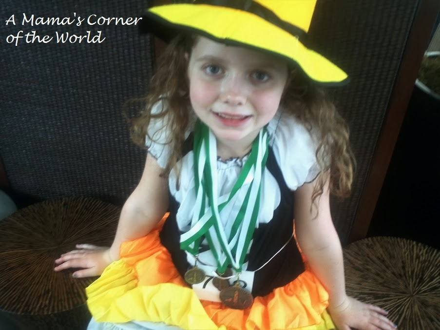 the 2nd place medal at macys level qualifies her for the 2014 oireachtas in that dance but she still needs to earn 1 2or 3 in her other three dances - Halloween Feis