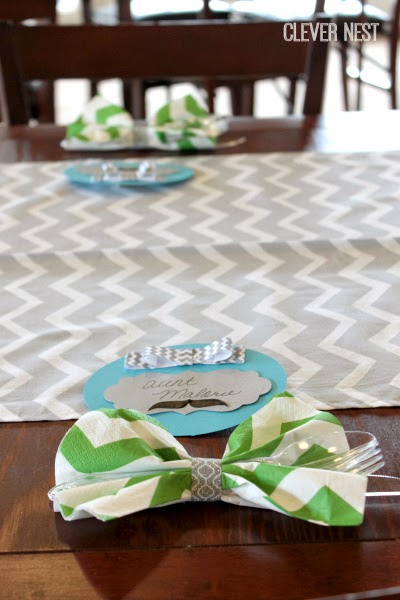 amazingly cute bow tie cutlery napkins. Use an inch or so of washi tape to secure it. Little Man themed baby shower at Clever Nest #aquagraylime #boysfirstbirthday #hipsterparty #littlemantheme #clevernest #babyshowergameideas
