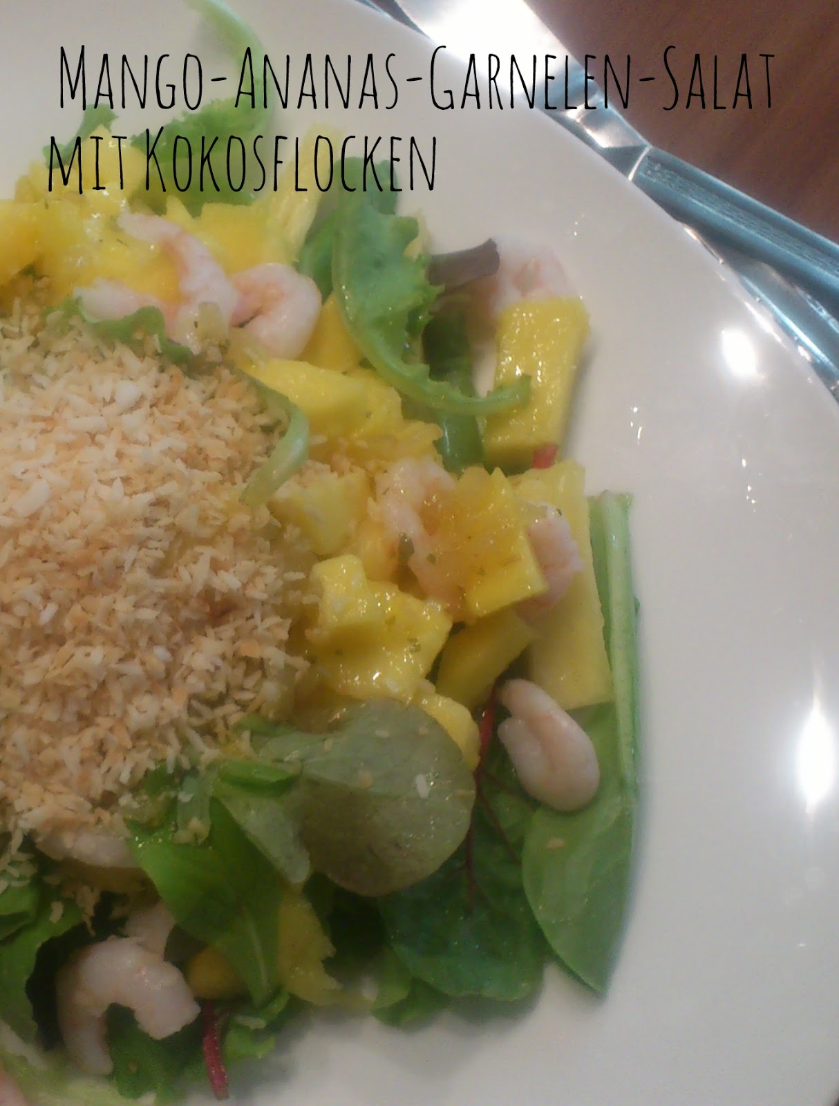 Mango-Pineapple-Shrimp-Salad with coconut flakes