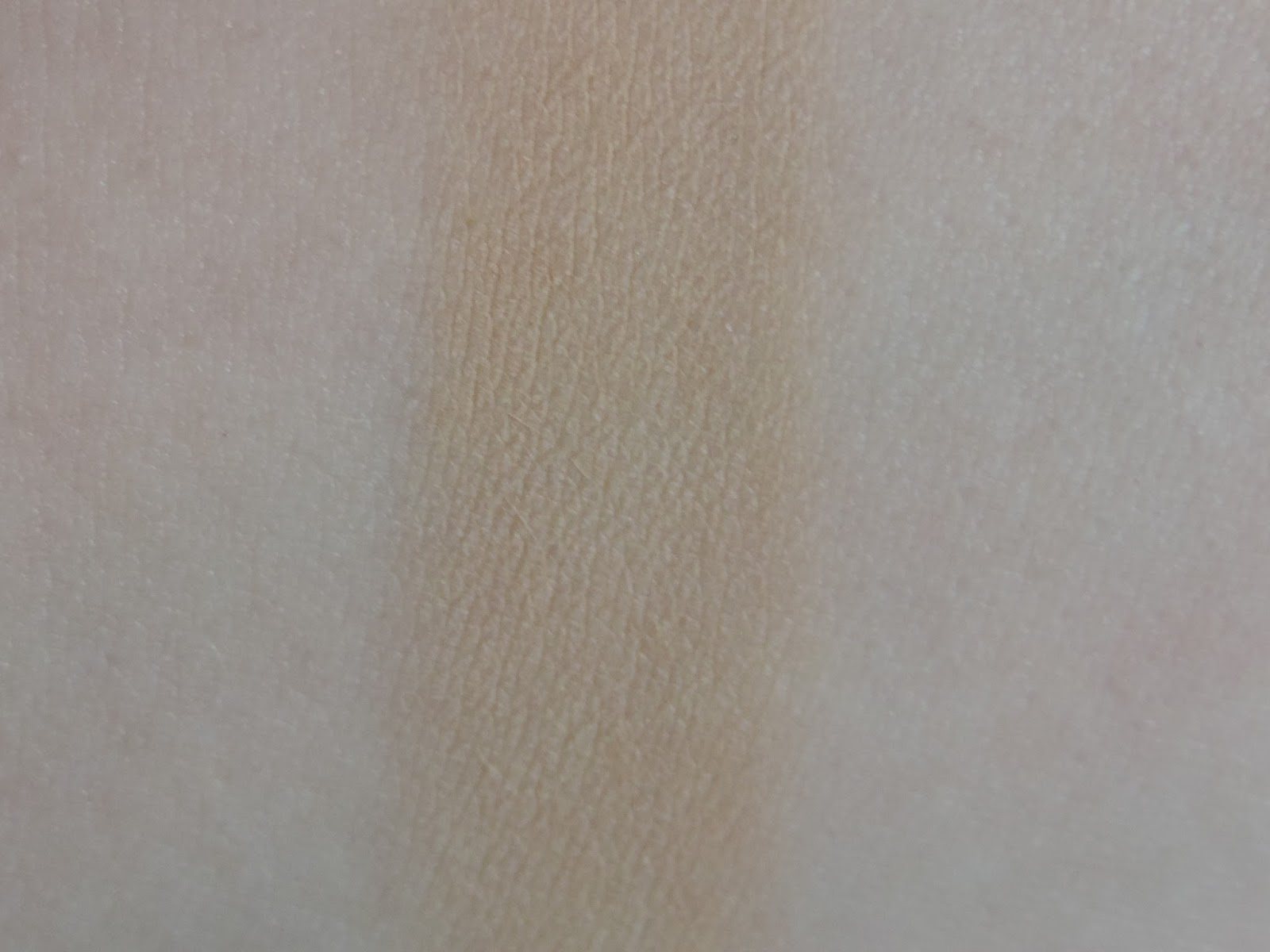Swatch of Urban Decay Naked Skin Ultra Definition Powder Foundation in Medium Neutral