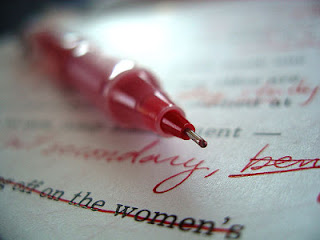 Editing Paper With Red Pen