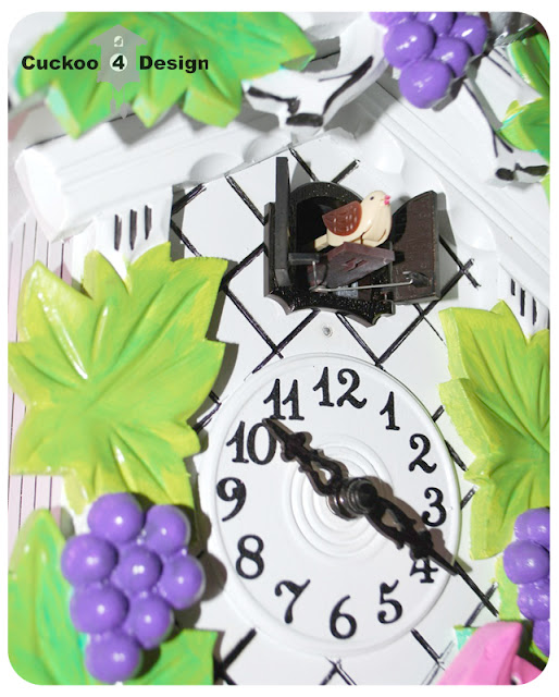 lime green, silver, pink, purple, black and white cuckoo clock