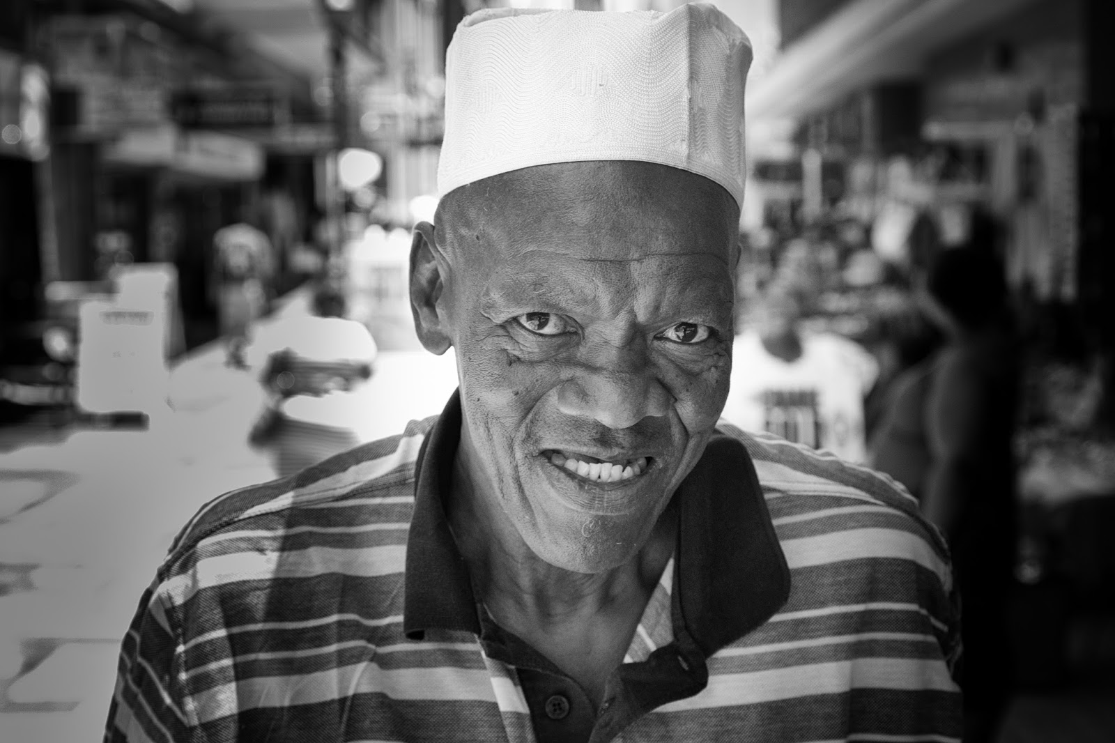 A street portrait of a fruit vendor on Annerley street Cape Town.