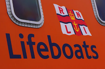 R N L I          saving lives at sea