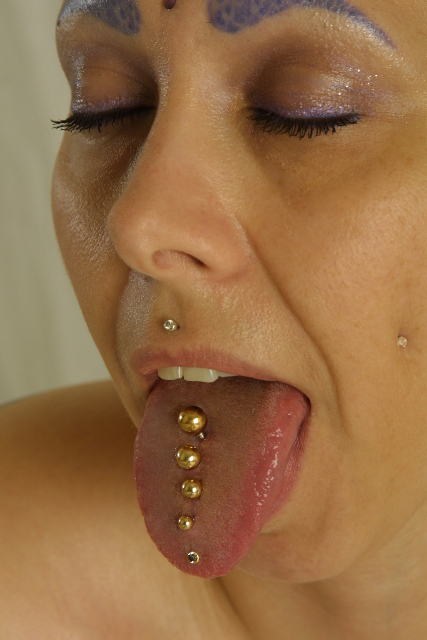 Stuff from ellen 39 s head speaking in tongues for Tattooed and pierced porn