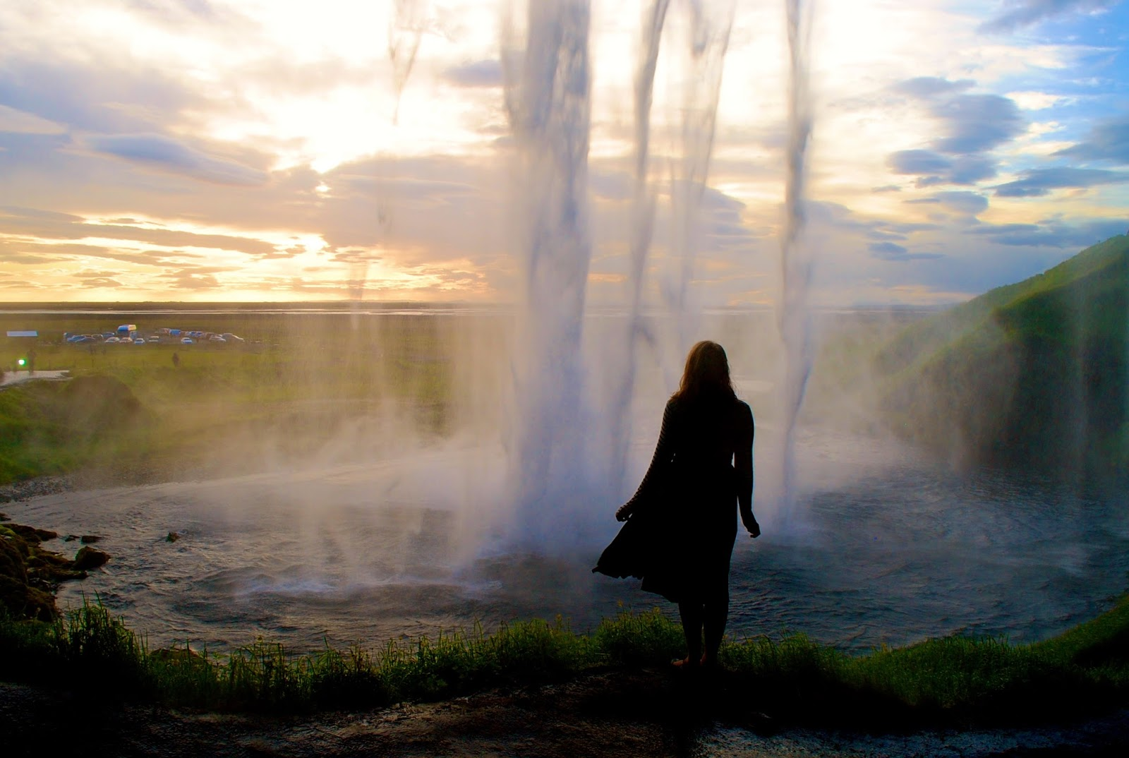 Sunset from behind Seljalandsfoss waterfall on the South Coast of Iceland
