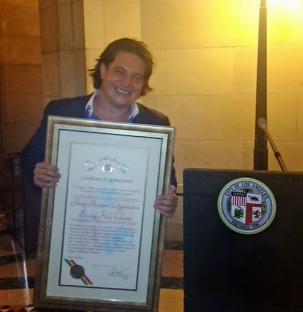 camilo concha with certificate of appreciation from the City of Los Angeles