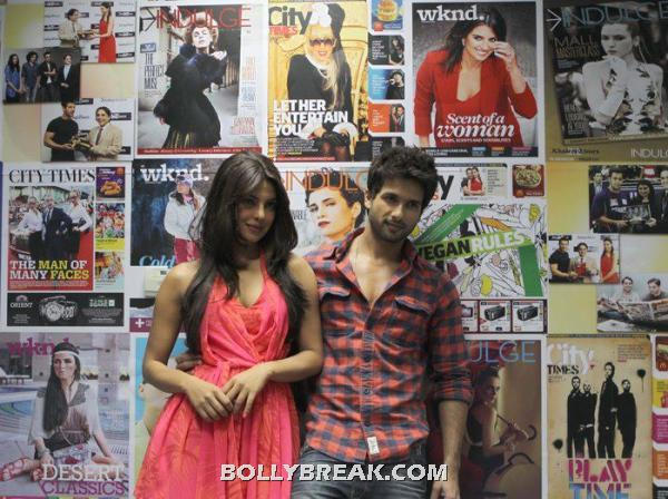 Priyanka in a short coral dress and shahid is some casuals.  -  Priyanka Chopra & Shahid Kapoor promotingTMK @ Khaleej times