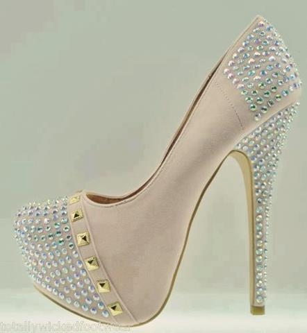 Nice stylish high heel shoes for ladies with silver shining dots