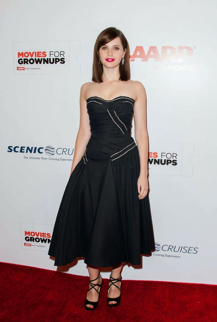 Felicity Jones in a strapless dress at the 2015 AARP The Magazine's Movies for Grownups Awards Gala in Beverly Hills