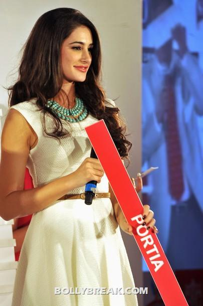 Nargis Fakhri in white dress  -  Hot Nargis Fakhri at the Kingfisher pre-derby event