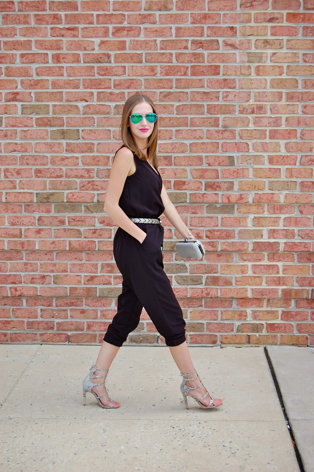 Wearing all black jumpsuit, BCBGeneration gladiator Manci heels, Vintage snake belt, blue mirrored aviator sunglasses