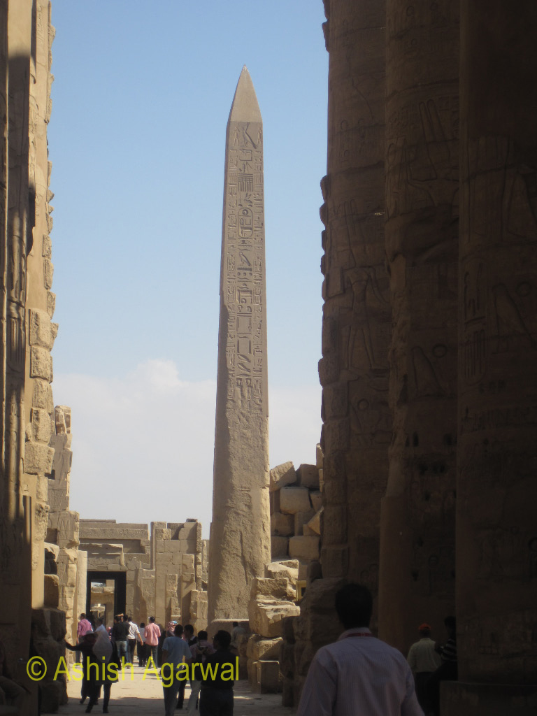 View of a large obelisk, as one walks inside the Karnak temple in Luxor