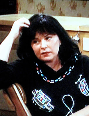 Roseanne from the TV Show Roseanne wearing an ugly sweater
