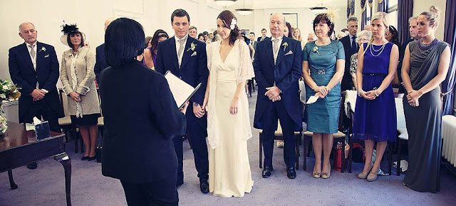 bride groom officiant and both families at Marylebone Town Hall wedding