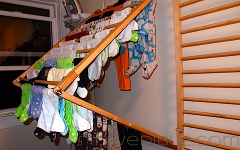 Drying rack in laundry room made from old playpen folds flat :: OrganizingMadeFun.com