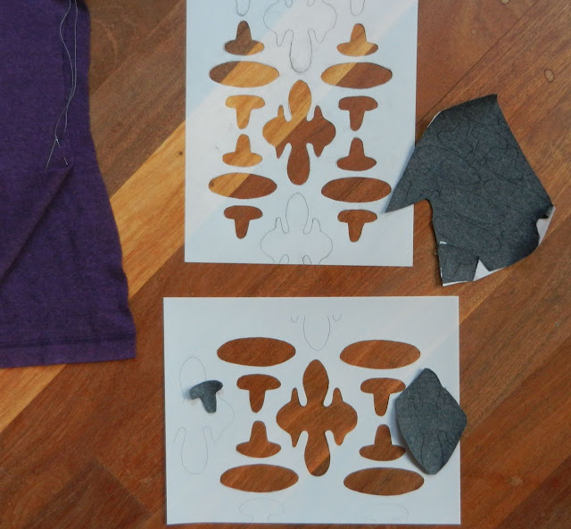 Two cut out stencils