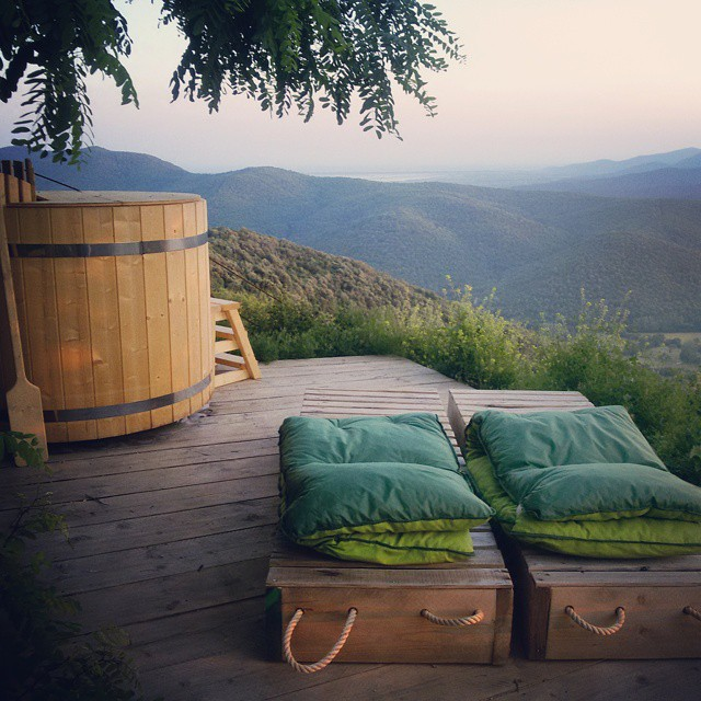 Hot tub and day beds with a view at il Baciarino in Vetulonia