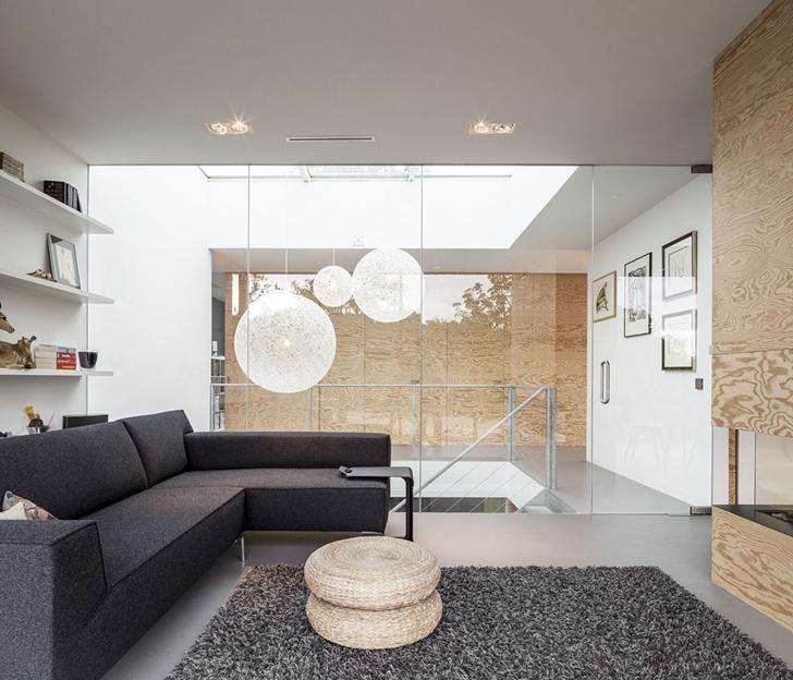 Upper floor living area in Modern Villa V by Paul de Ruiter Architects
