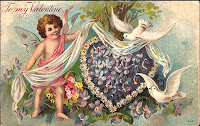 antique embossed valentine postcard post card with heart, bird, cherub and flowers