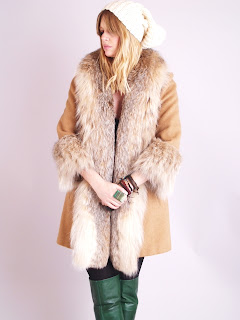 Vintage camel colored swing coat with lynx fur collar and cuffs.