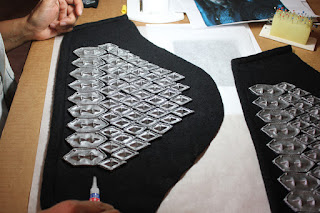 Gluing the scales on Thorin's sleeves.