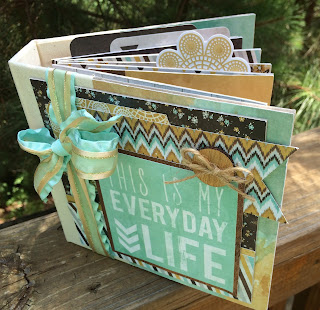 http://www.artsyalbums.com/2014/06/a-brand-new-mini-album-kit-giveaway.html