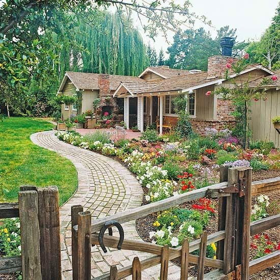 Photozzoflife add curb appeal brighten your entryway for Colorful front yard landscaping