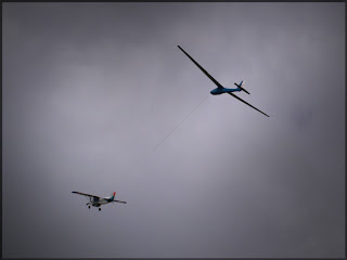 Aerotowing a glider aloft, not easy but great fun.