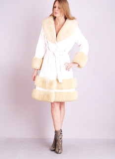 Vintage 1960's Lilli Ann cream colored shearling coat with belted tie front closure.