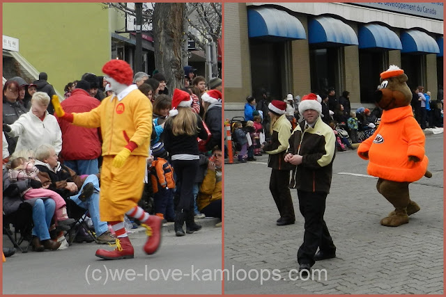 the well known characters walk in the Santa parade