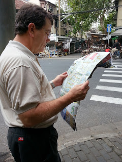 Tourist reading a map at DOng Tai Lu market in Shanghai