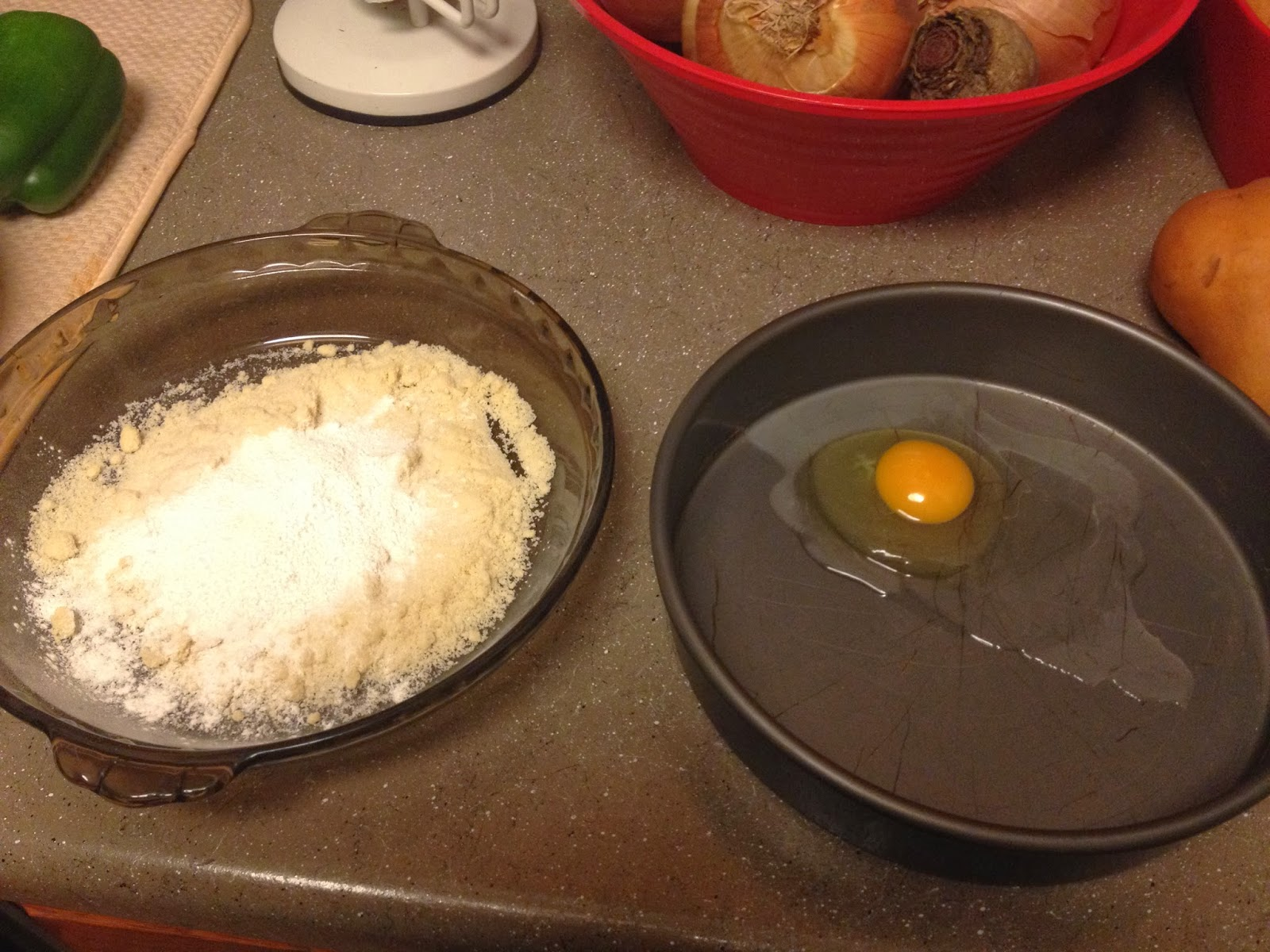 4) Using Your Flattened Pork Chops, Dip One Into The Egg Mixture And Then  Straight Into The Flour Mixture Make Sure You Evenly Coat Both Sides Of  The Chop