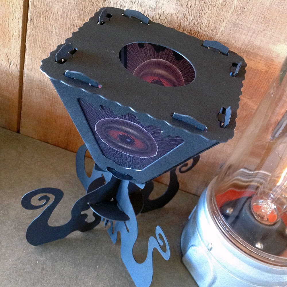 Peering at top of cephalopod vintage-style lantern by Bindlegrim for spooky lighting in home decor.