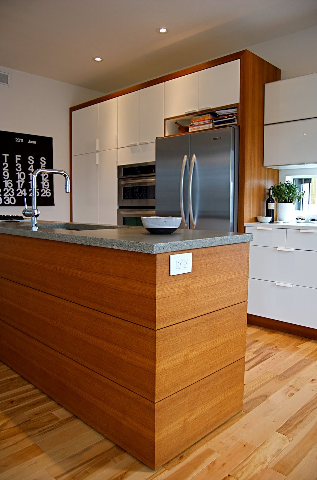 Prairie perch stylish saskatchewan modern element for Modern teak kitchen cabinets