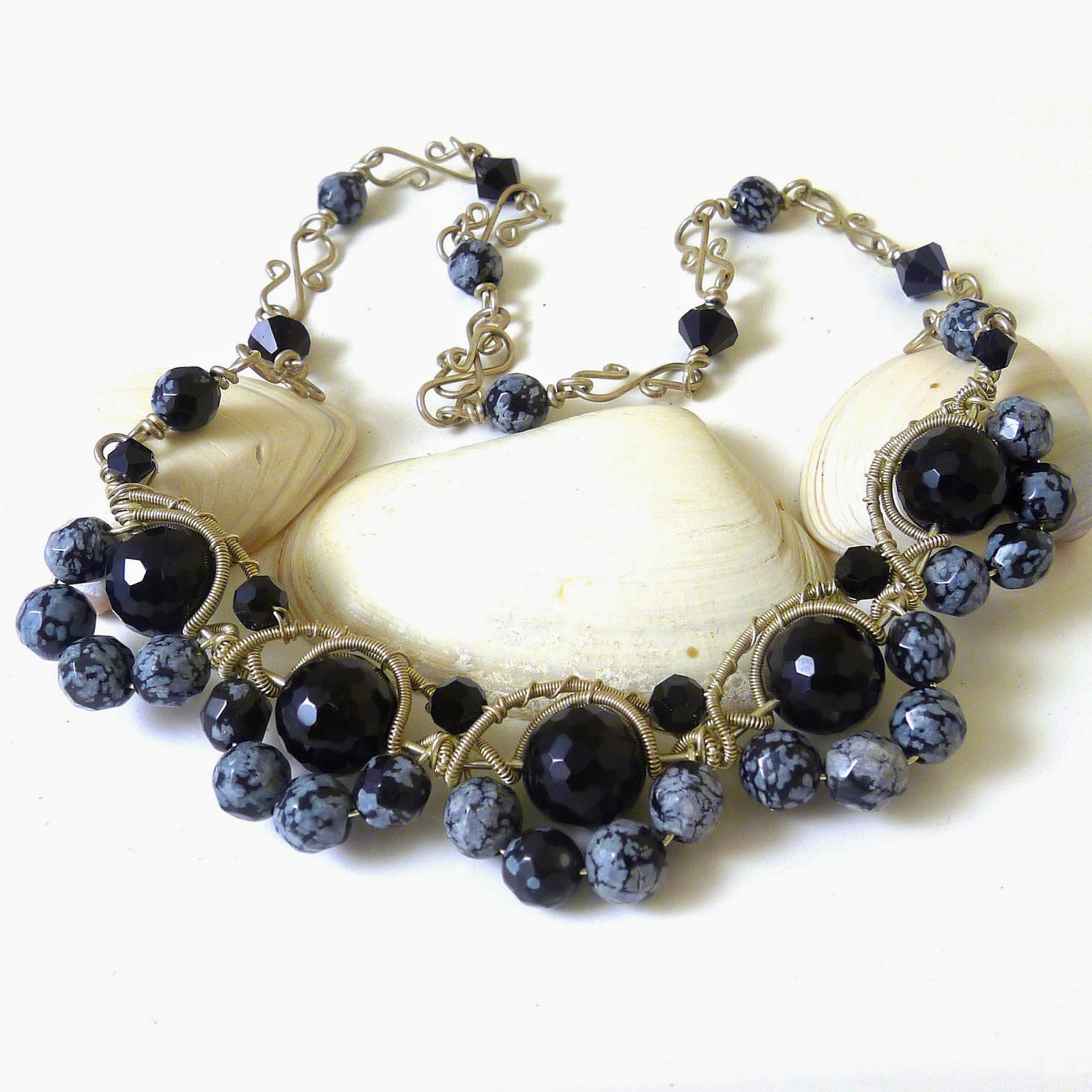 http://www.shazzabethcreations.co.nz/#!product/prd1/2228333761/onyx-and-snowflake-obsidian-necklace
