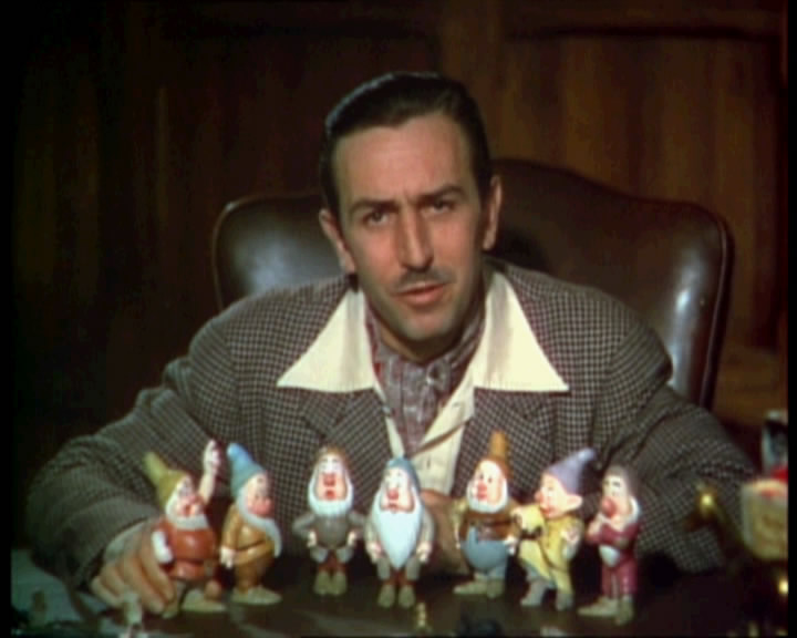Walt Disney posing with 7 dwarfs animatedfilmreviews.filminspector.com