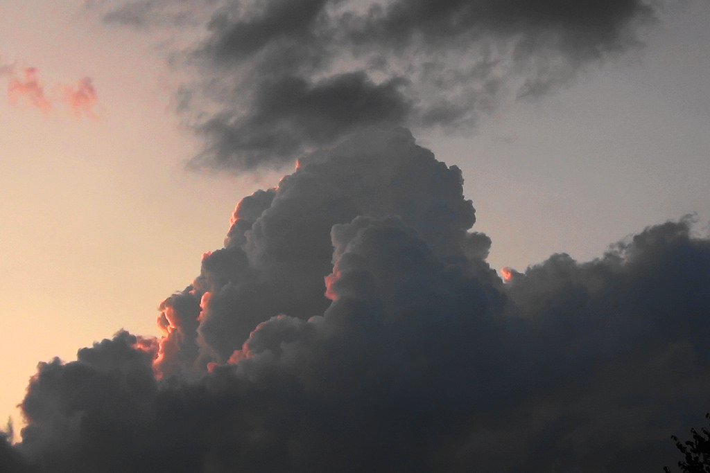 Dark cumulonimbus cloud at sunset over Poland