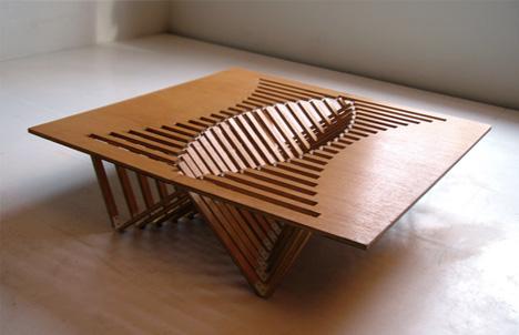 Mesa plegable como si fuera dedos entrelazados la for Flat pack muebles