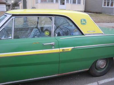 Green car with a yellow hardtop and yellow side stripe, plus John Deere logo