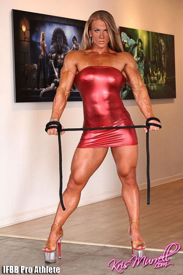 Kris Murrell Modeling Her Muscular Arms And Legs In A Red Dress
