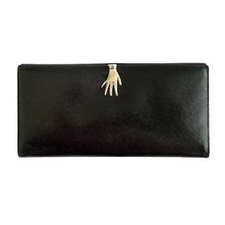Vintage 1950's black Gucci clutch with metallic hand closure.